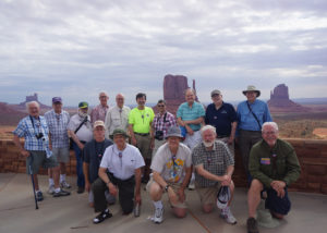 Group of men posing for a picture in the desert