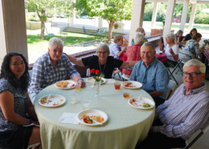 Five people eating lunch at a table