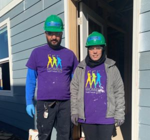 A man and a woman working for Habitat for Humanity