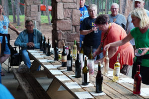 Adults participate in a wine tasting